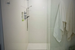Walk-in shower no door, heated bench and floors - bown sons enterprises renovation bathroom